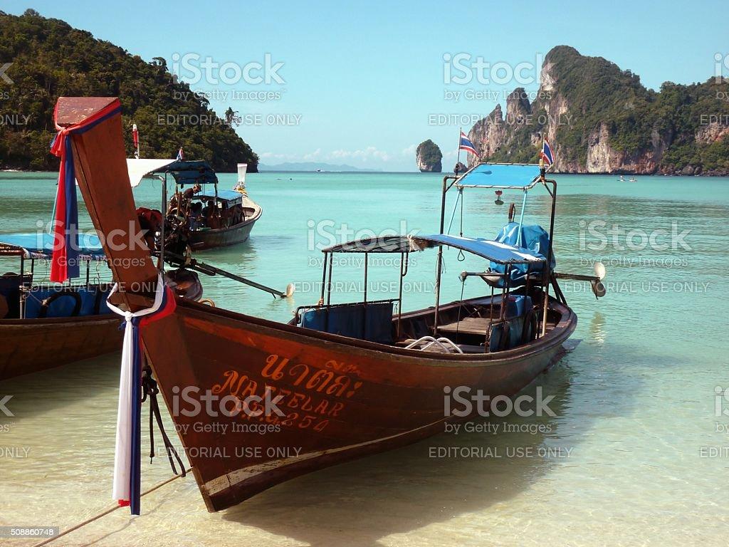 Long Tail boats at Loh Dalum beach, PhiPhi island, Thailand stock photo
