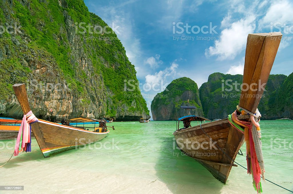 Long tail boats on the beach on an island stock photo