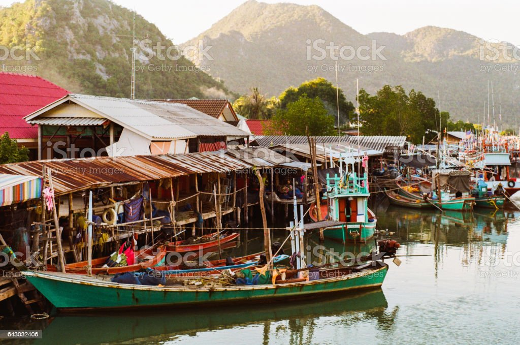 Long tail boats on the pier in the village stock photo