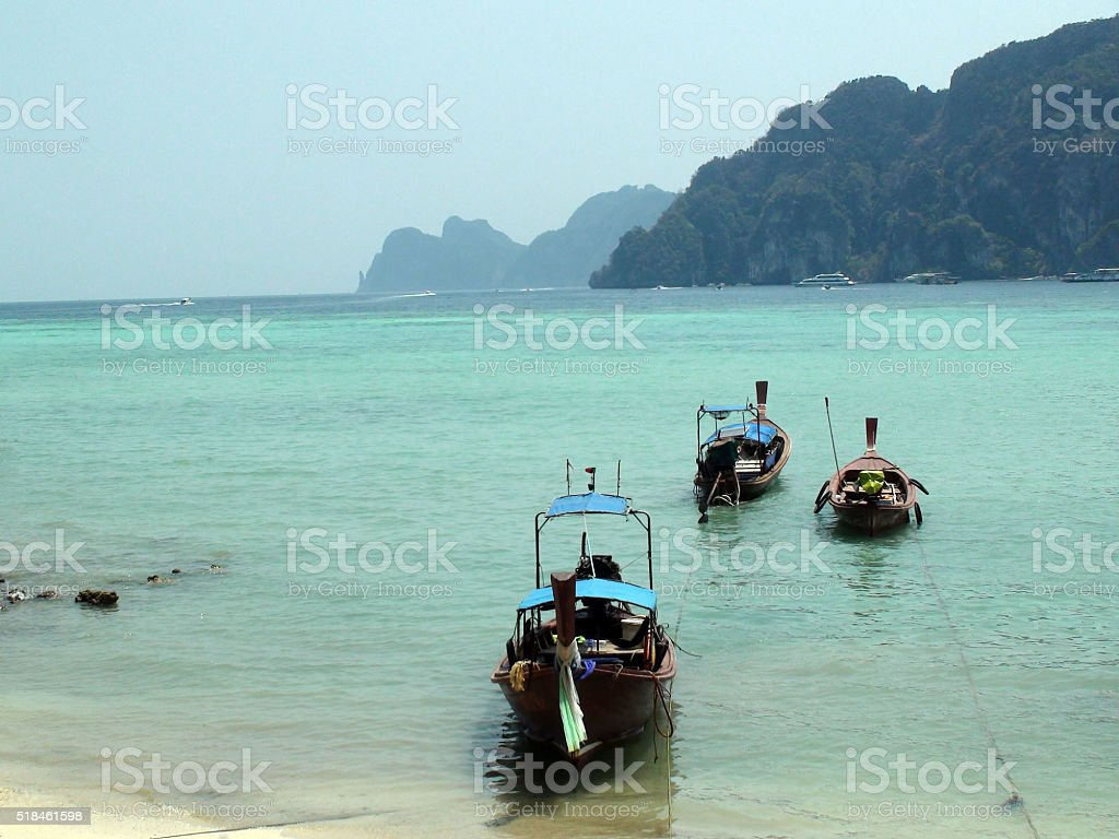 Long Tail Boats On Tonsai Bay In Phi Phi Island.Thailand stock photo