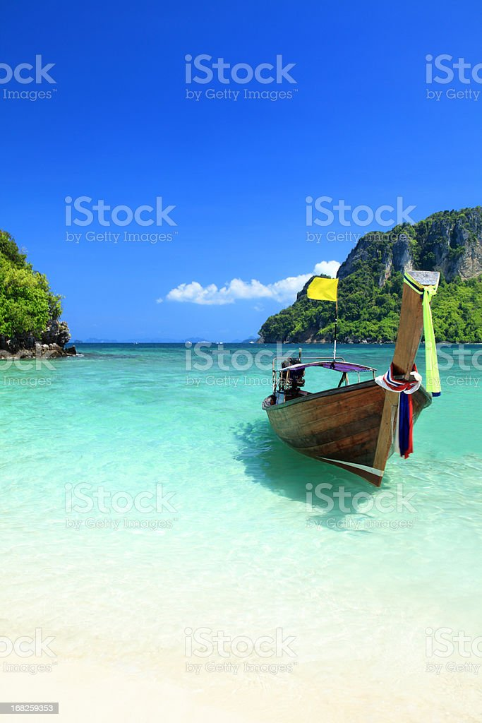 Long tail wooden boat at Krabi island beach royalty-free stock photo