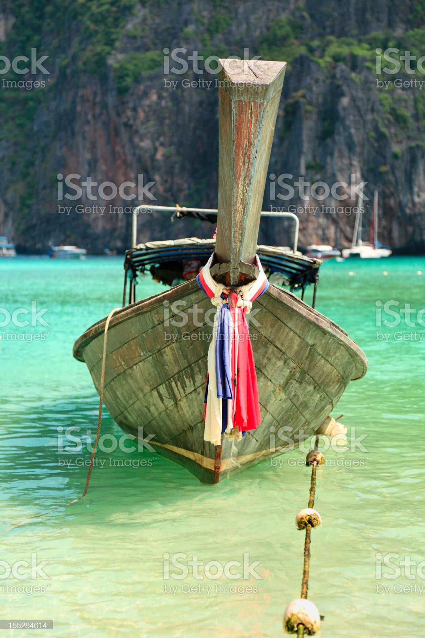 Long tail wooden boat moored at Maya Bay royalty-free stock photo