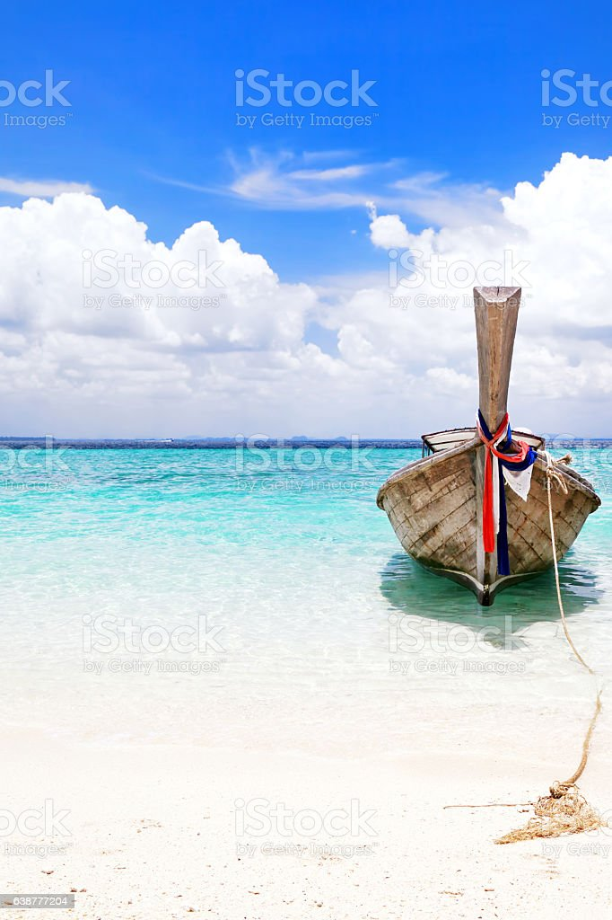 Long tail wooden boat stranded at Krabi island beach stock photo