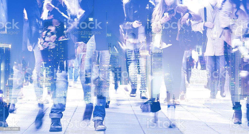 Long time exposure of pedestrians, city skyline stock photo