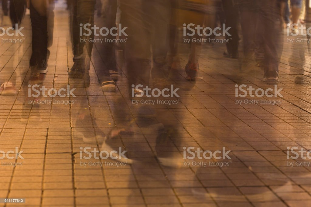Long time exposure of pedestrians stock photo
