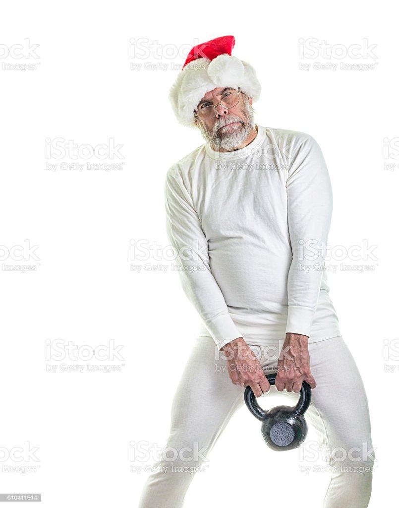 Long Underwear Santa Claus Straining To Lift Heavy Kettlebell Weight stock photo