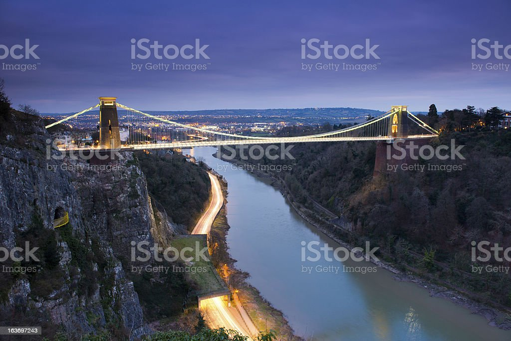Long view picture of a suspension bridge at night stock photo