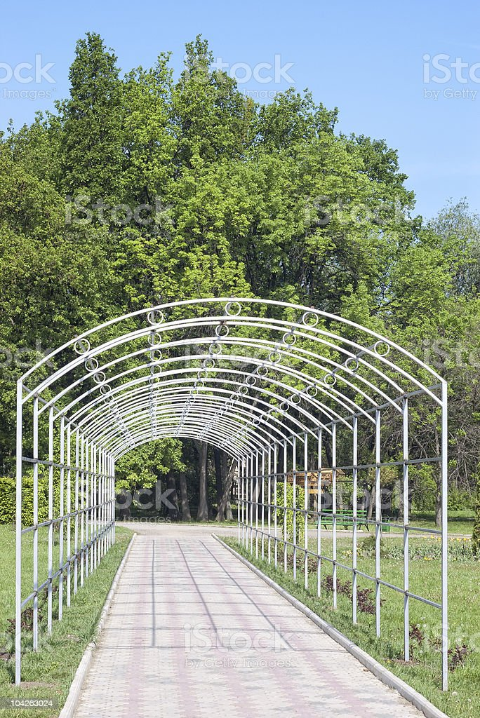 long white arch in park stock photo