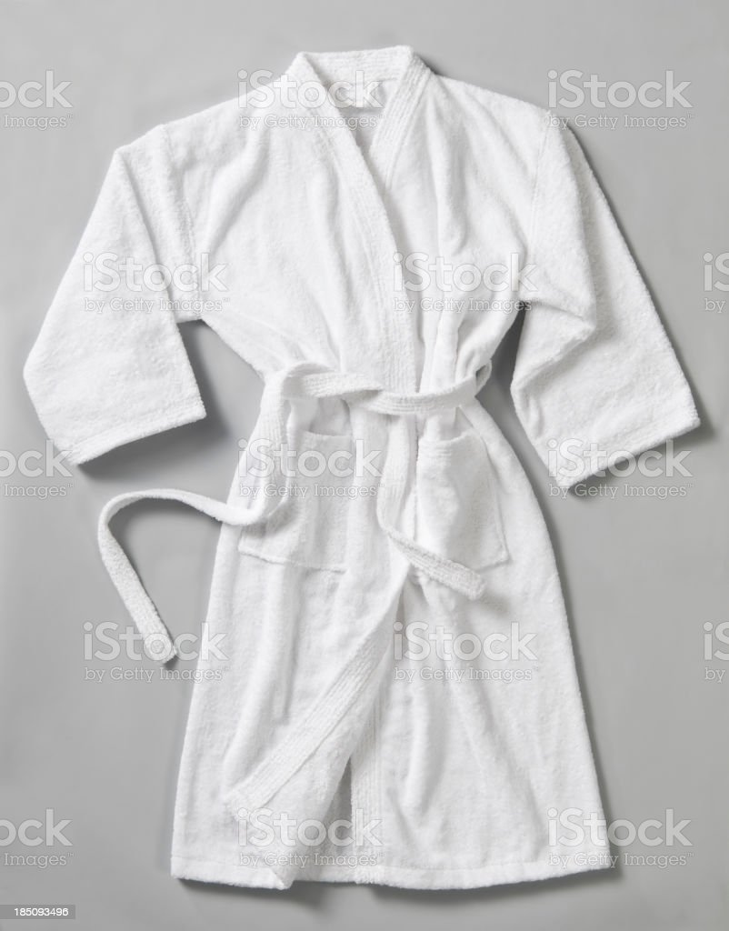Long white bathrobe on the gray surface  stock photo