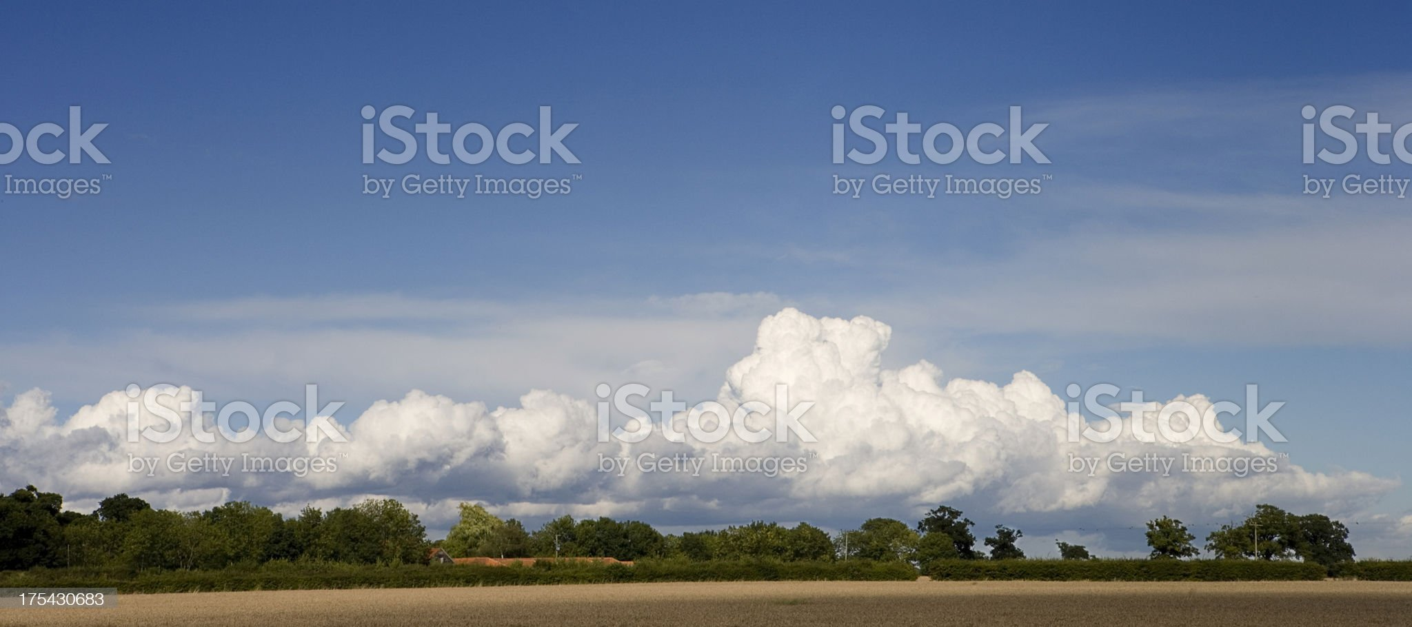 Long white cloud over Norfolk, England. royalty-free stock photo