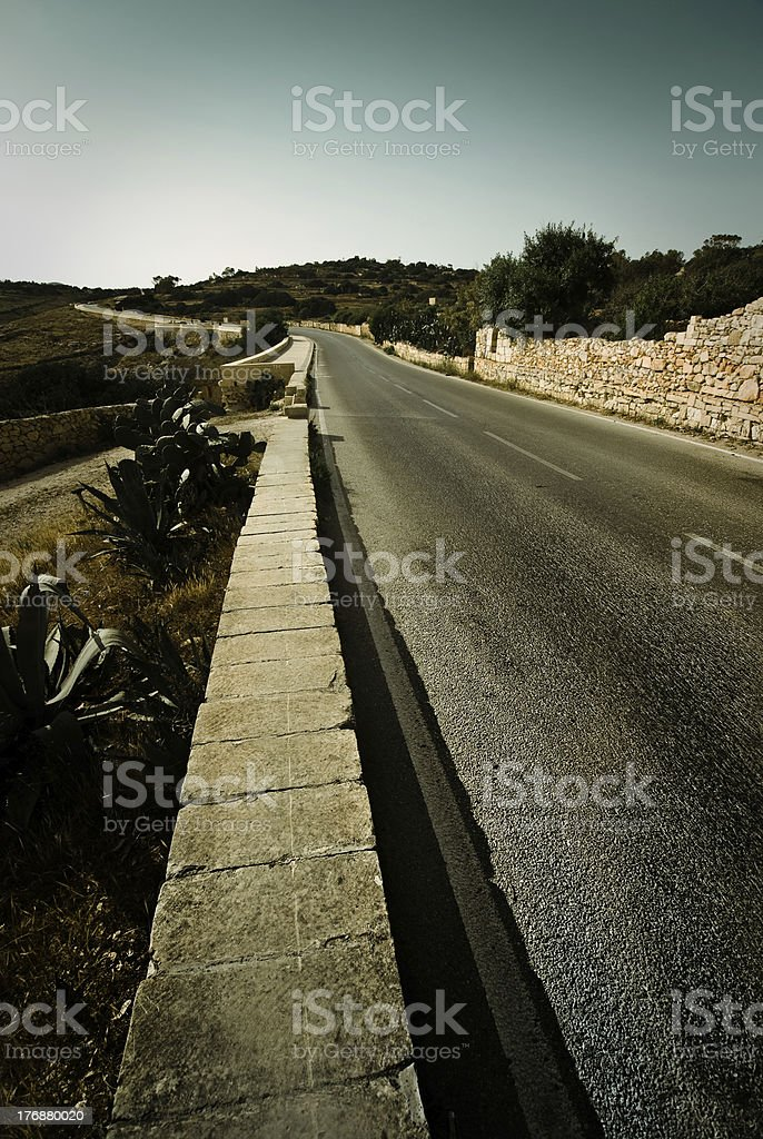 long winding road in Qrendi, Malta royalty-free stock photo