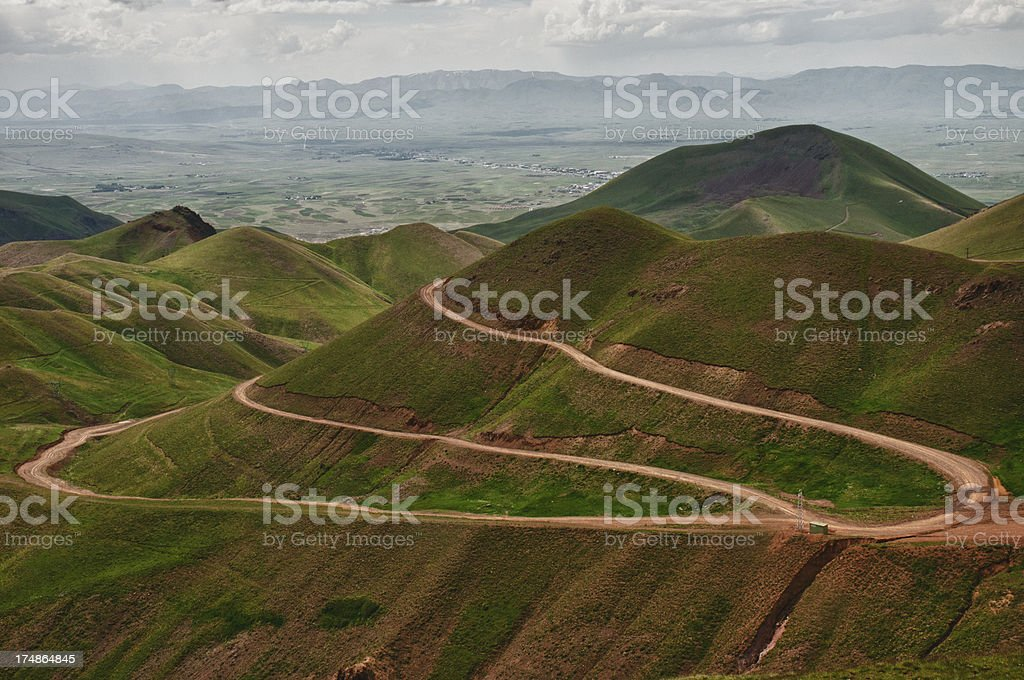 Long Winding Road Through Mountains royalty-free stock photo