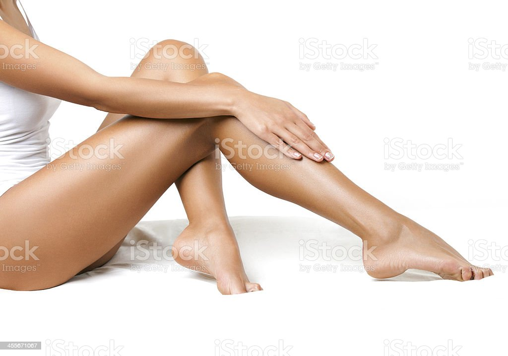 Long Woman Legs isolated on white. Depilation stock photo
