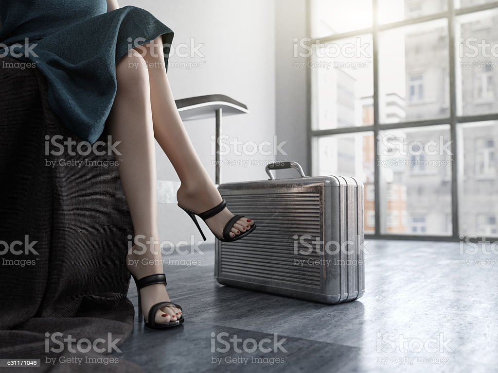 Long Woman Legs with metal case  concept background stock photo