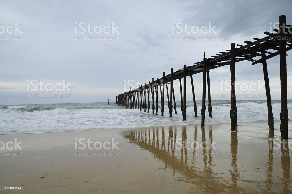 Long Wooden Bridge on the beach with reflection royalty-free stock photo