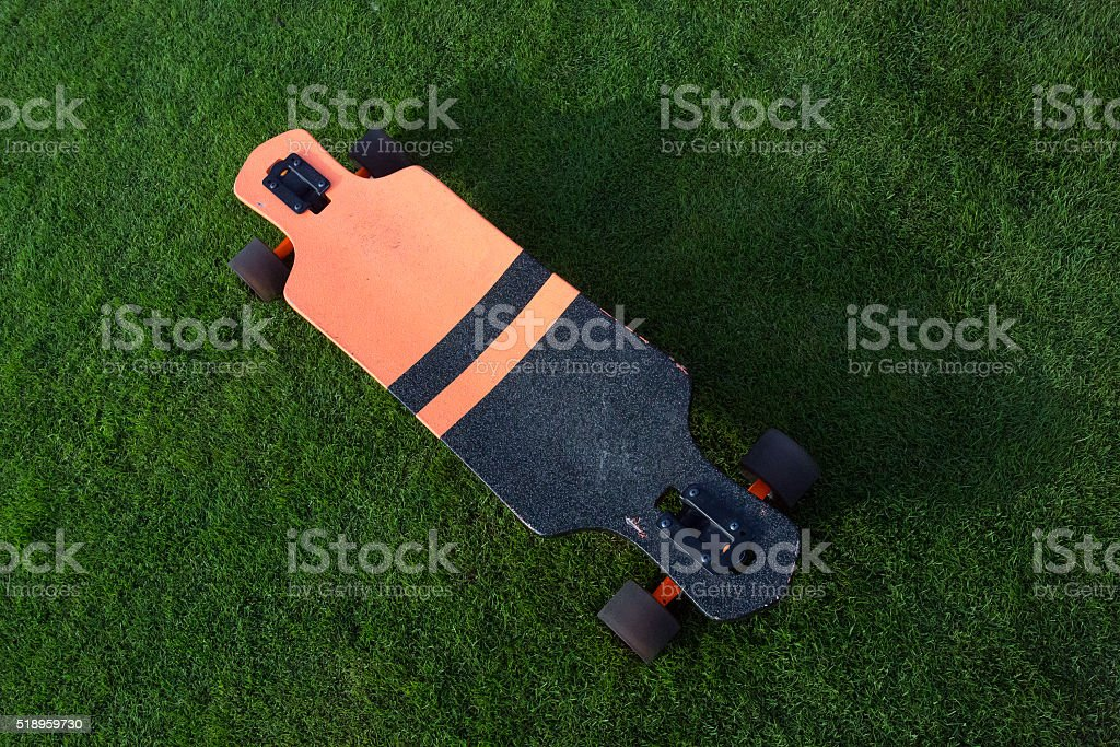 longboard grass green stock photo