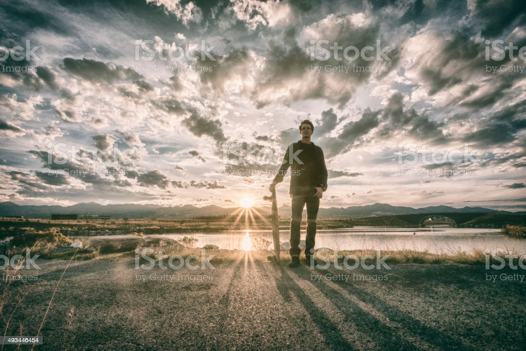 Longboarder at Sunset stock photo