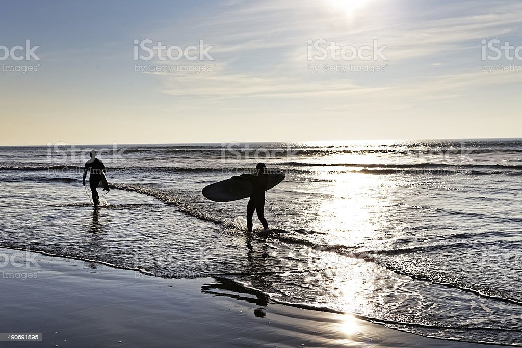 Longboarders at sunset royalty-free stock photo