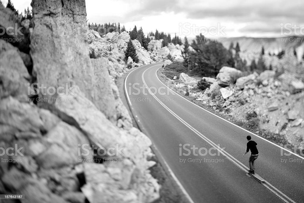Longboarding (skateboarding) on the open road royalty-free stock photo