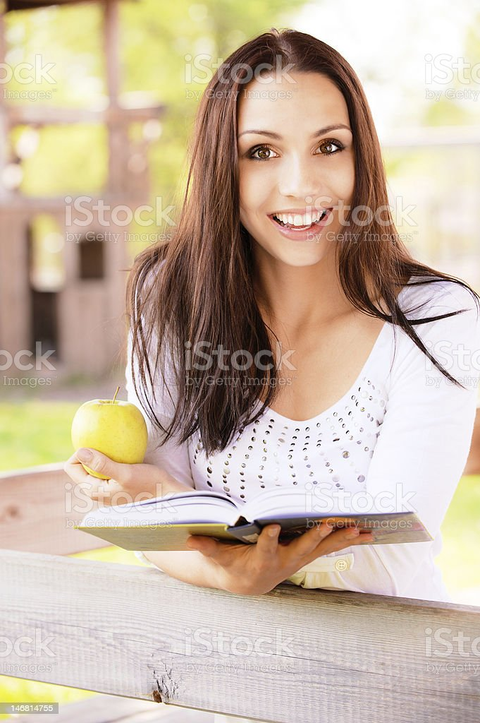 Long-haired girl reads book royalty-free stock photo