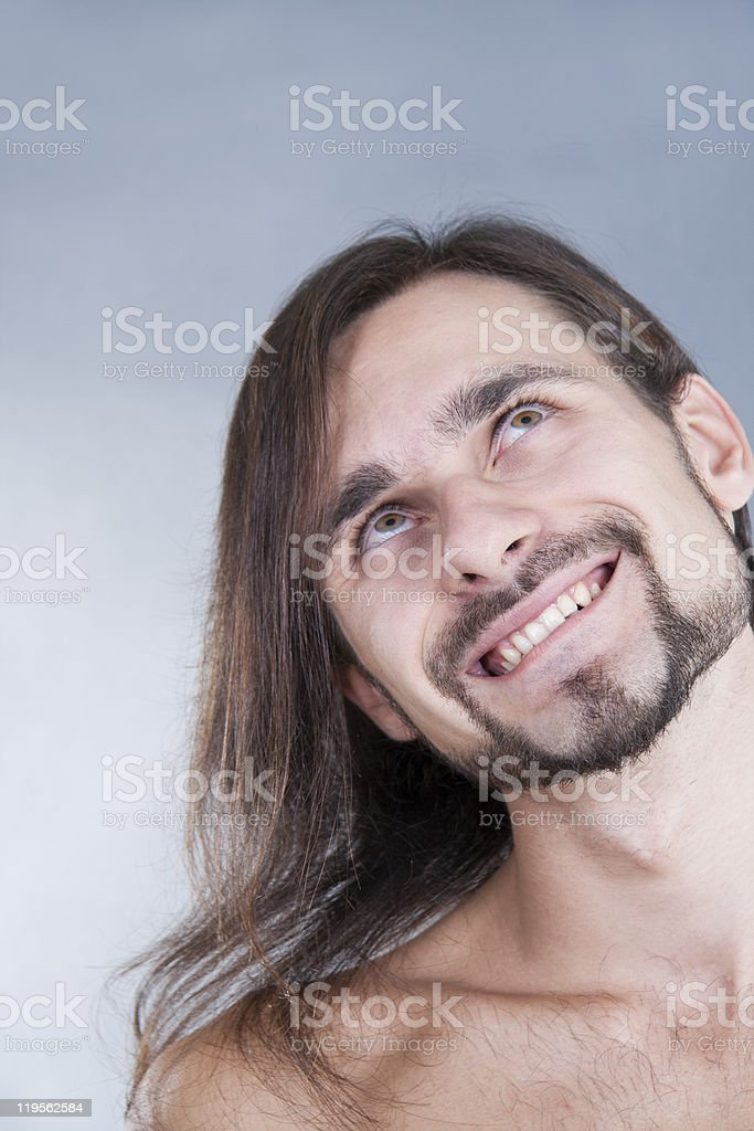long-haired pensive caucasian man stock photo