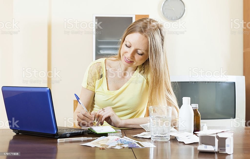 long-haired woman reading about medications  in internet royalty-free stock photo