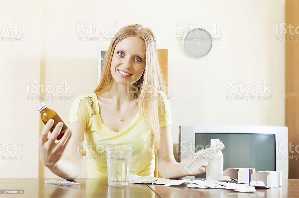 Long-haired woman with medications royalty-free stock photo