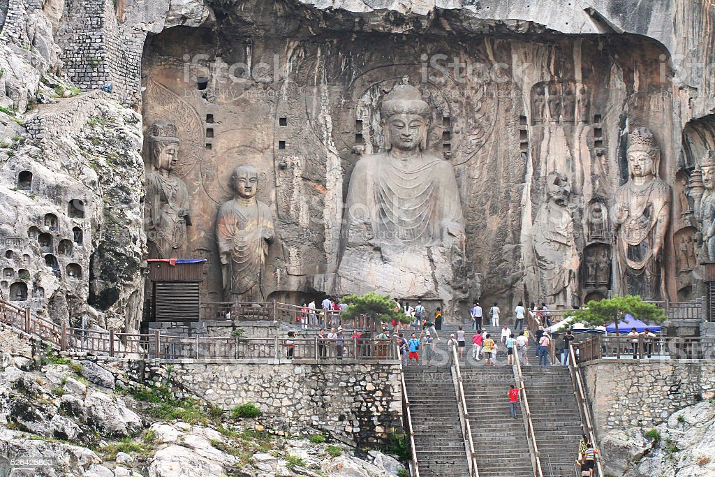 Longmen Grottoes caves with Buddha's figures in Luoyang, China. stock photo
