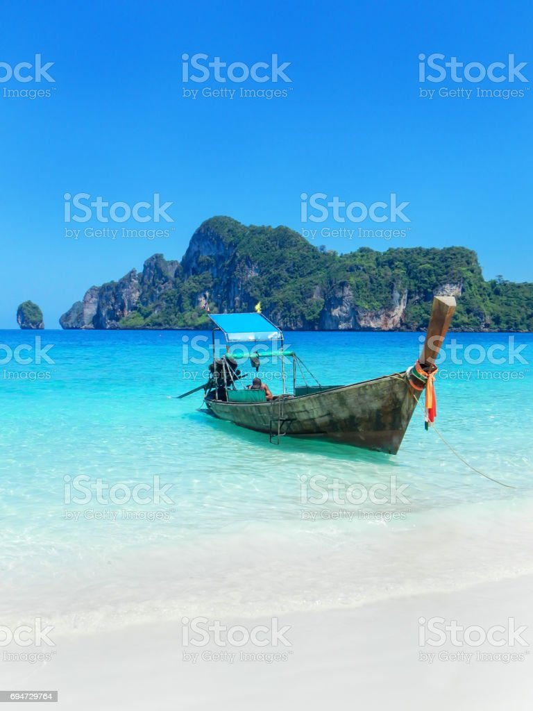 Longtail boat at the beach on Phi Phi Don, Thailand stock photo