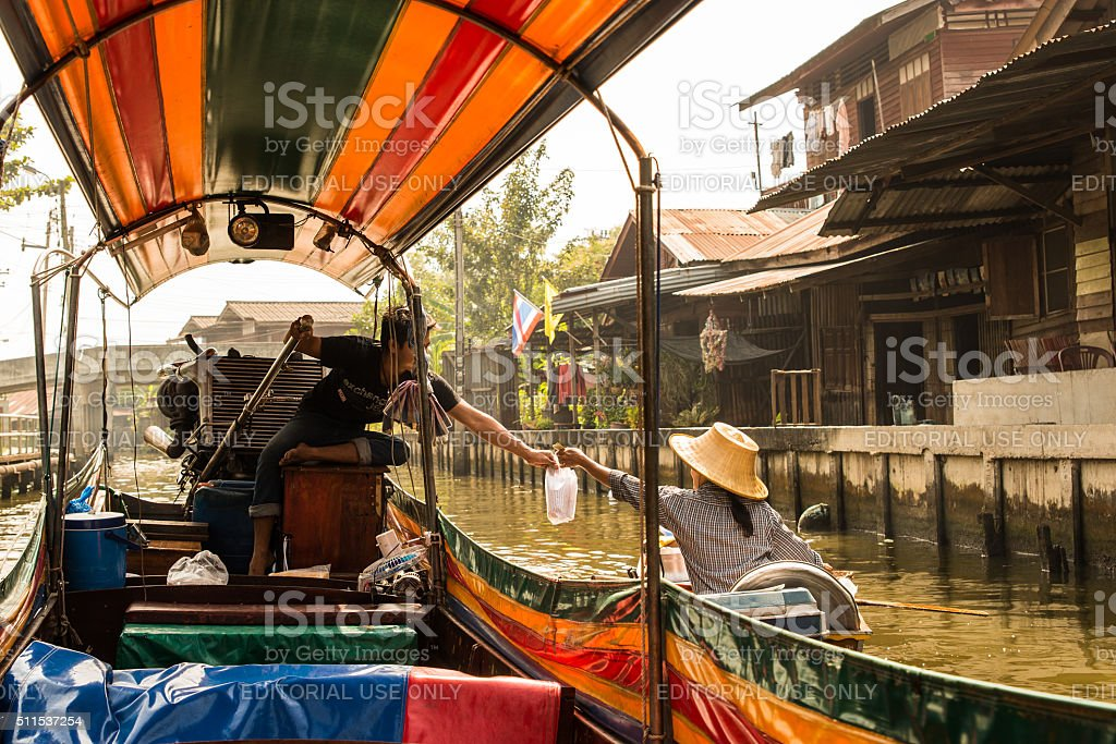 Long-tail Boat Buying Goods from Boat in Bangkok, Thailand stock photo