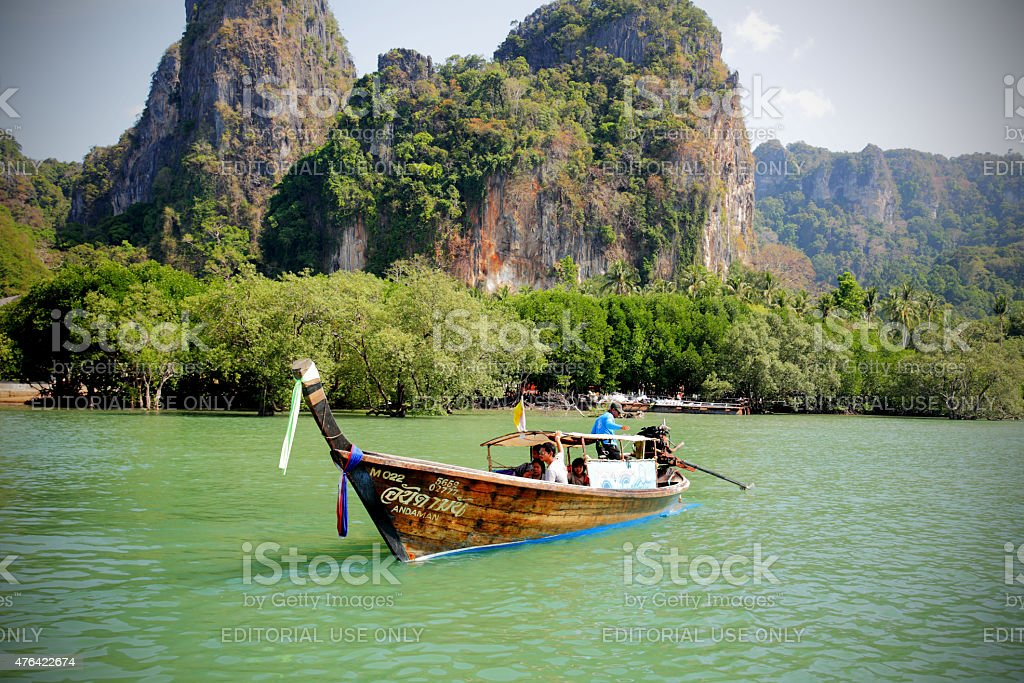 Longtail boat carrying passengers at Railay in Thailand stock photo