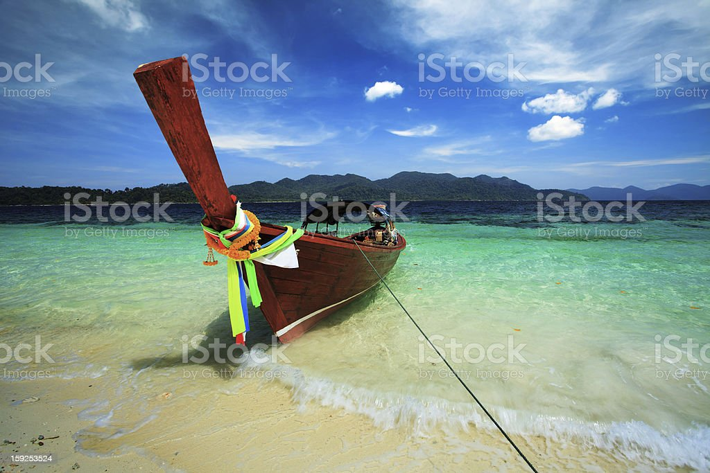 Longtail boat in deep blue sea royalty-free stock photo