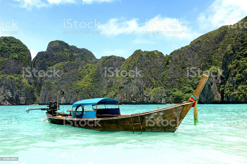 Longtail boat near May Bay beach royalty-free stock photo