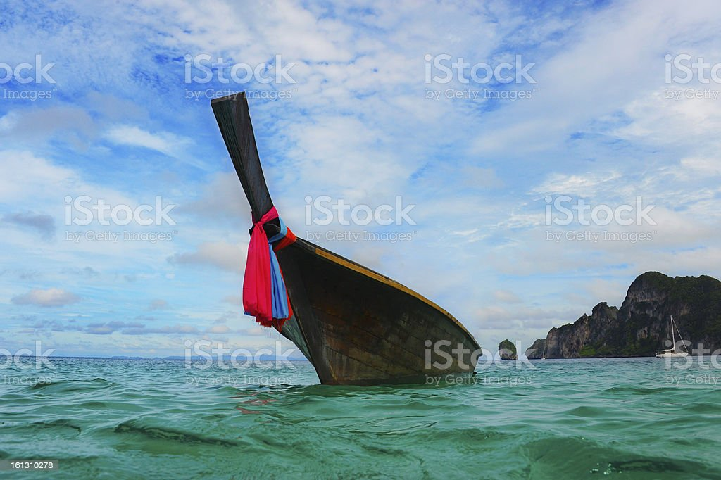 Longtail boat on the sea tropical beach royalty-free stock photo