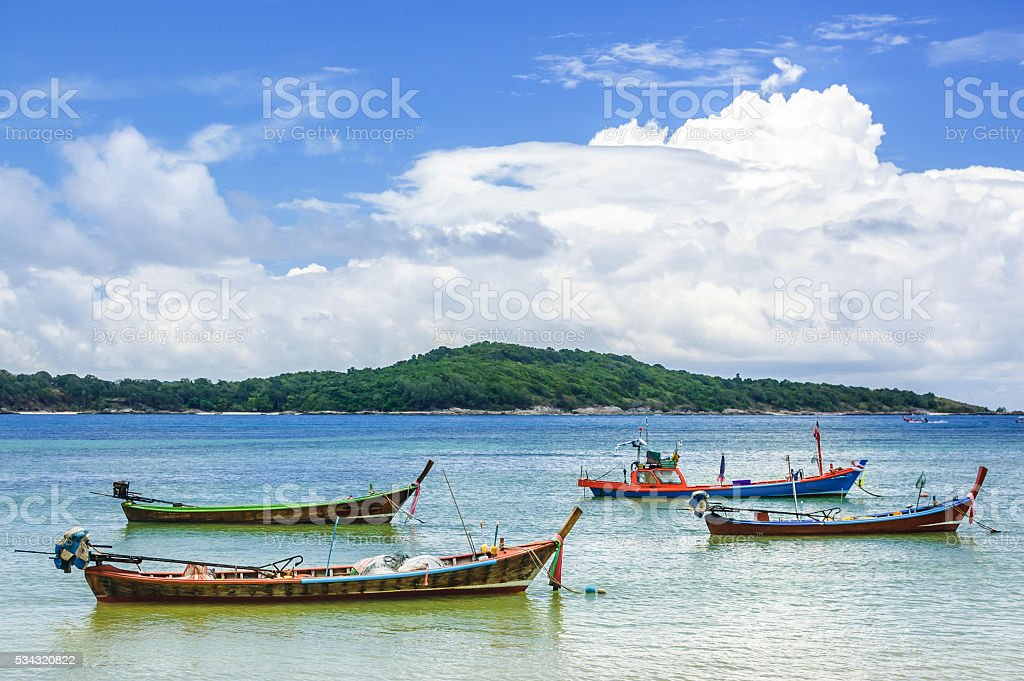 Long-tail boats at anchor, Phuket, Thailand stock photo