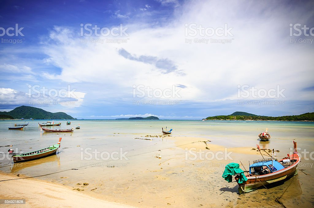Long-tail boats at low tide, Phuket, Thailand stock photo