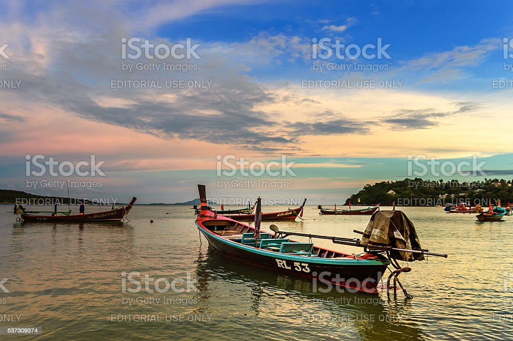 Long-tail boats at sunset, Phuket, Thailand stock photo