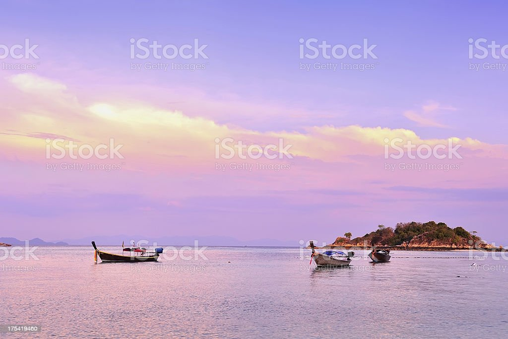 Longtail boats at Sunset stock photo