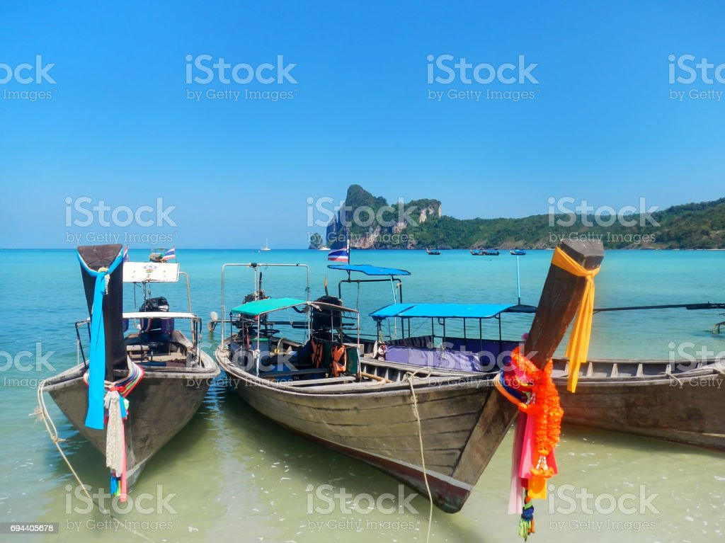 Longtail boats at the beach on Phi Phi Don, Thailand stock photo