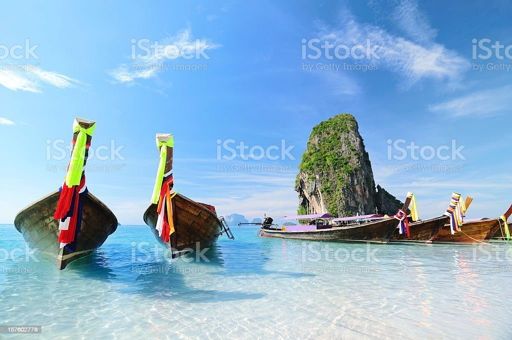 Longtail Boats at the beach on summer paradise tropical island royalty-free stock photo