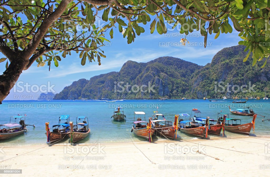 Longtail Boats at  Tropical Beach, Thailand stock photo