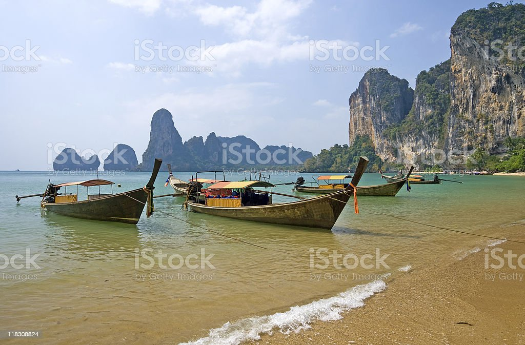Longtail boats on the Railay beach stock photo