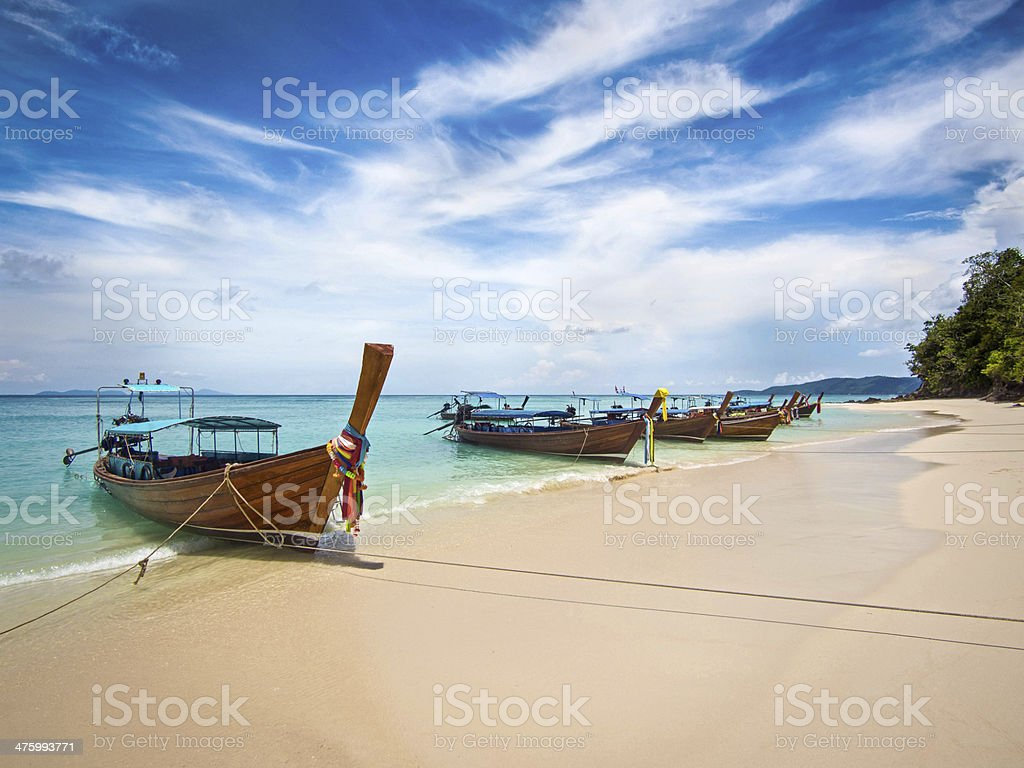 Longtail Boats on the Shore in Ko Phi Phi, Thailand stock photo