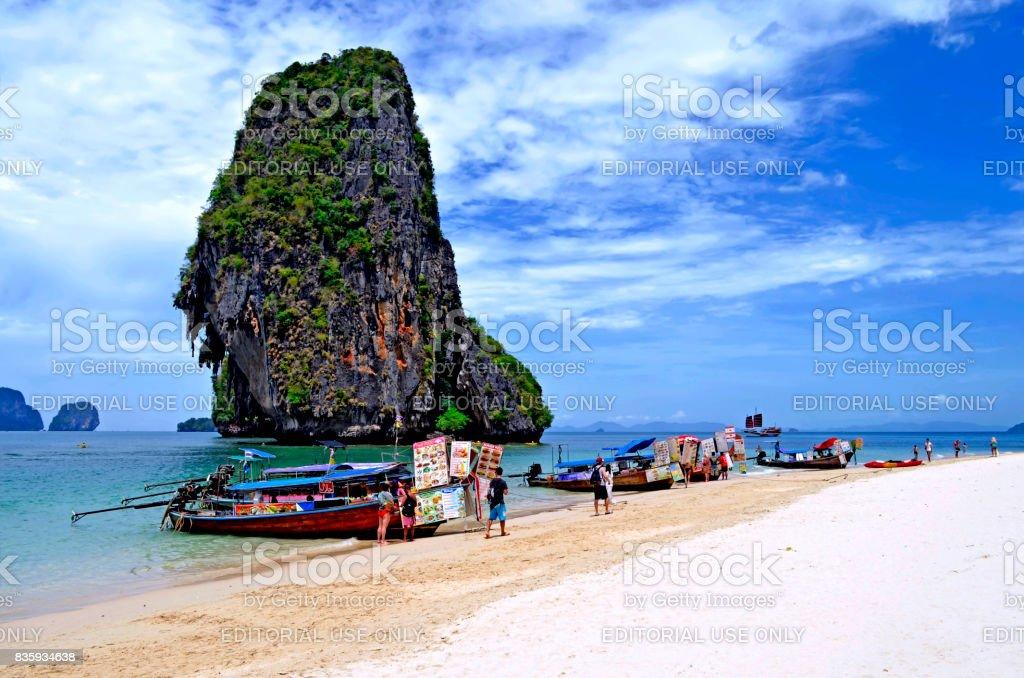 Longtail boats selling Thai food on Ao Phra Nang beach stock photo