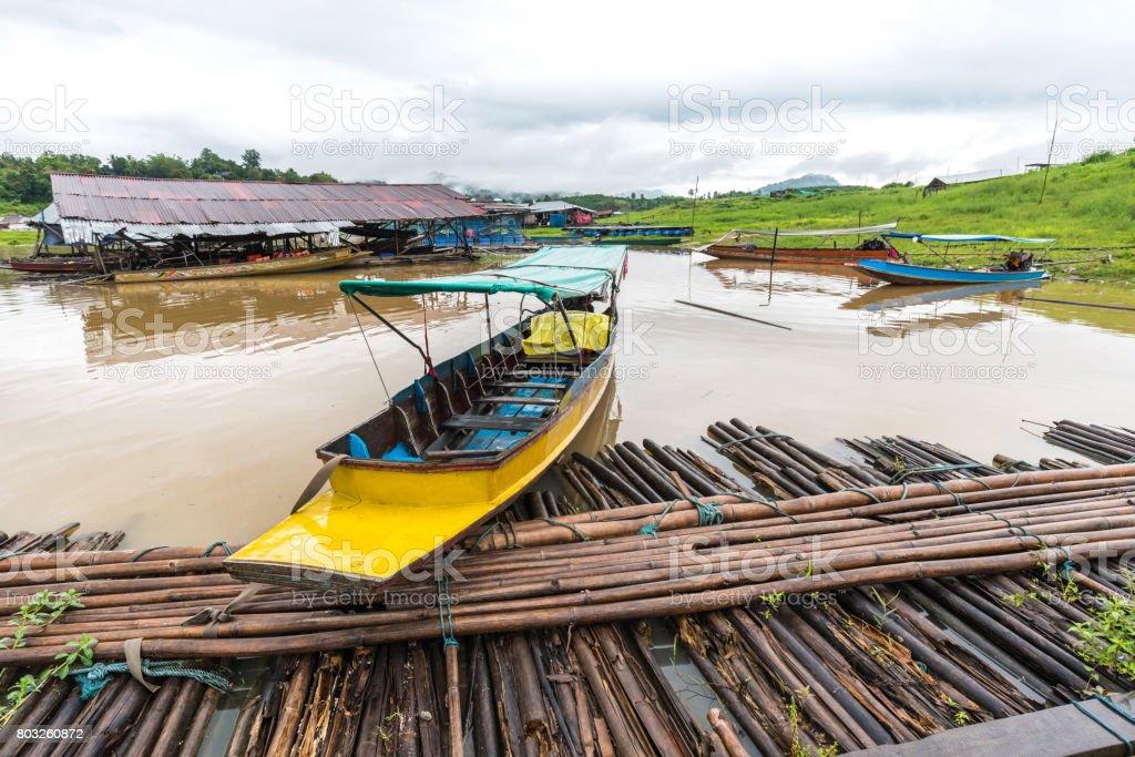 Long-tail Taxi boat in Sangkhlaburi wooden friendship bridge Thailand stock photo