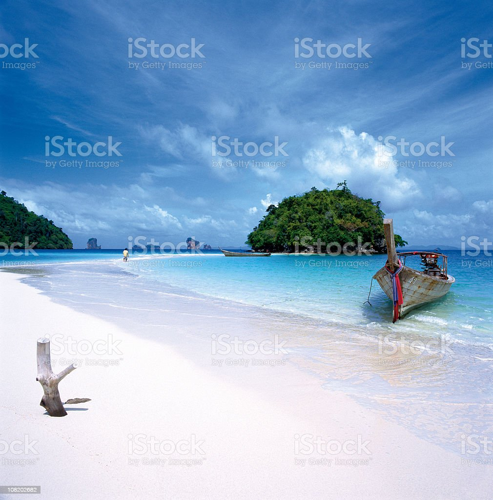 Long-Tailed Boat on White Sand Beach in Thailand. royalty-free stock photo