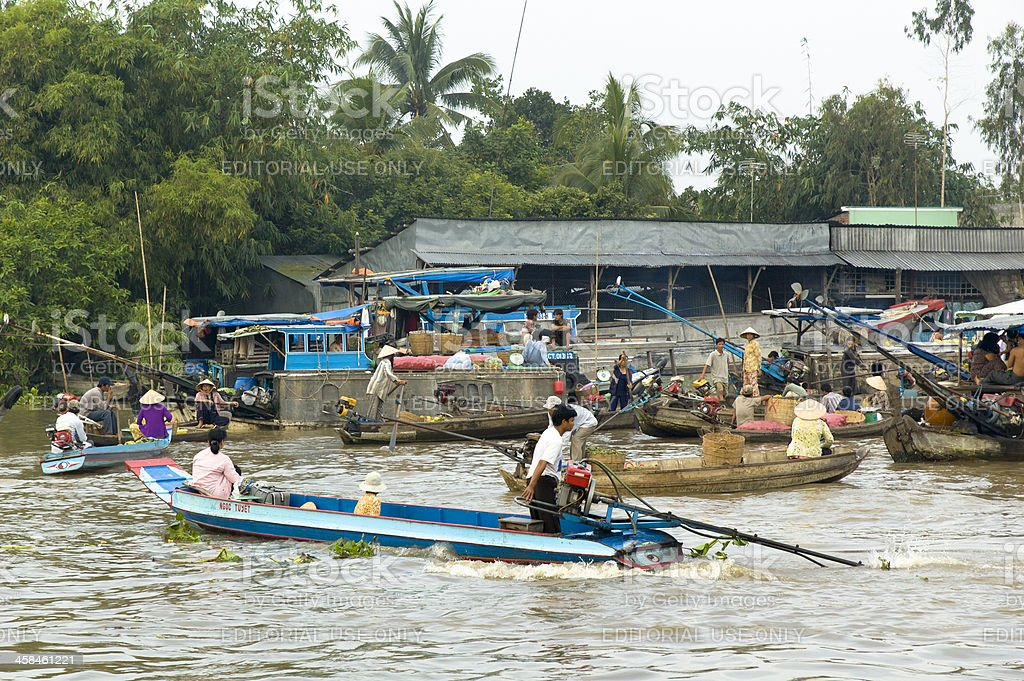 Long-Tailed Boats At Can Tho River Market stock photo