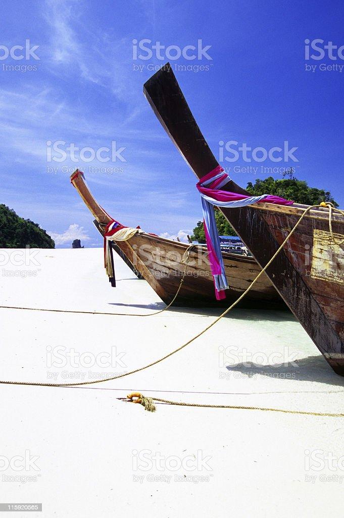 Longtails on a Thai Beach, Krabi, Thailand royalty-free stock photo
