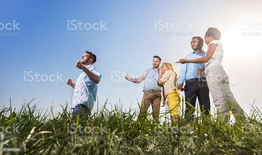 Look at him celebrating his success! stock photo