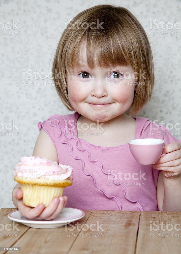 Look at my cupcake - Girl playing tea party stock photo